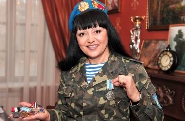 Женщина-миротворец. Она служила в Ираке